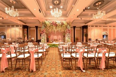 Photo of Pastel Pink Decor with Chandeliers