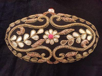 Photo of black bridal clutch