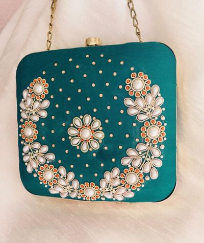 Photo of teal sling clutch