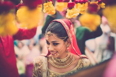 Photo of Bride Wearing Gold Coin Necklace