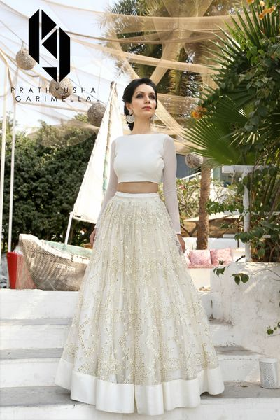 Photo of White and gold light lehenga for sister of the bride