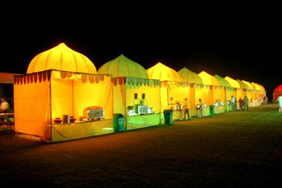 Photo of yellow and green food stalls