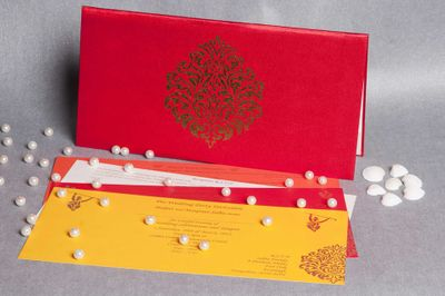 Photo of sold colour wedding invite red and yellow invites