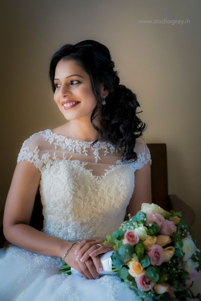 Photo of Bride posing in a beautiful white gown on her wedding day