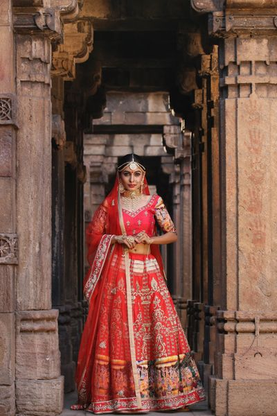 Photo of Red and gold bridal lehenga with contrasting border