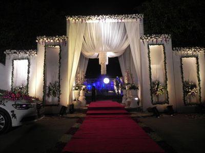 Photo of white theme wedding entrance decor