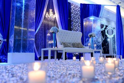 Photo of ice blue and white theme stage decor