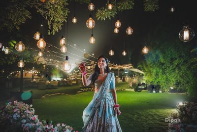 Photo of Pretty bridal portrait with lightbulbs