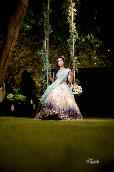 Photo of Bride on swing with leaves mehendi