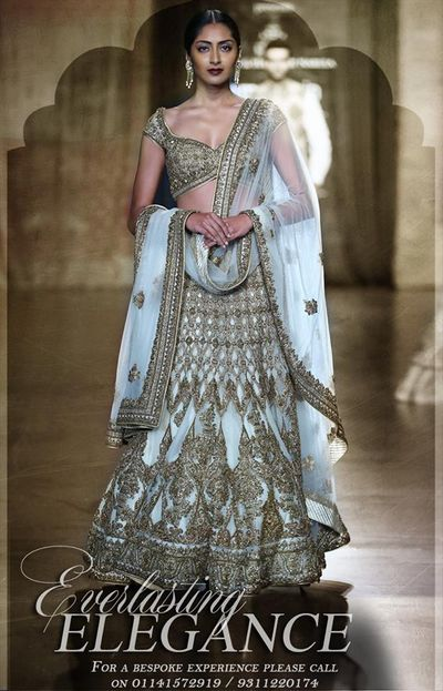 Photo of gold and white lehenga