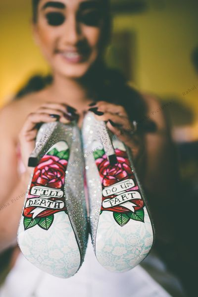Photo of Unique bridal shoes with message painted on sole