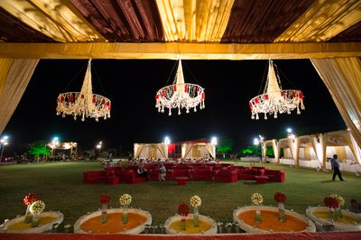 Photo of Marsala and Gold Tent with Floral Chandeliers