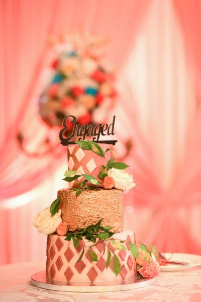 Photo of Light peach engagement cake with florals