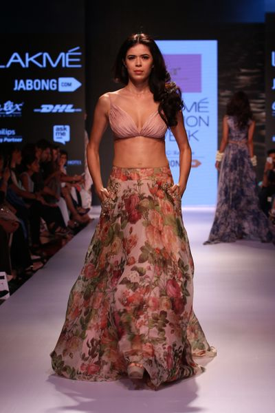 Photo of floral print lehenga with crop top jacket