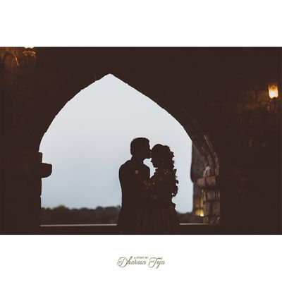 Photo of A groom kissing her bride on the forehead during an outdoor pre-wedding shoot.