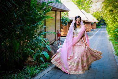 Photo of wedding day bridal shot in light pink lehenga