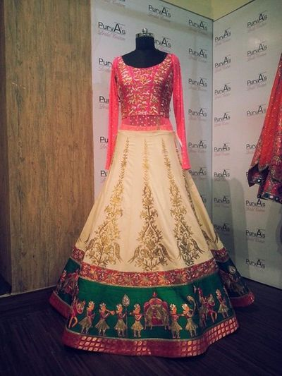 Photo of red and off white lehenga