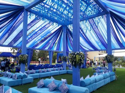 Photo of Vibrant and bright blue decor settings