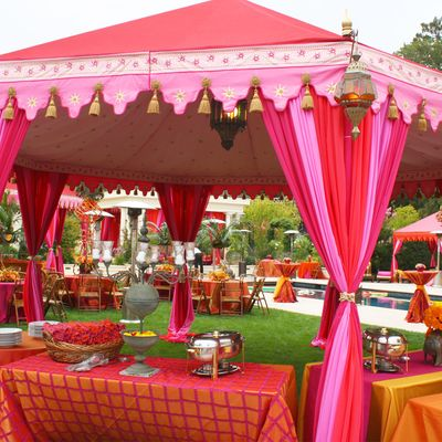 Photo of light pink and red tents