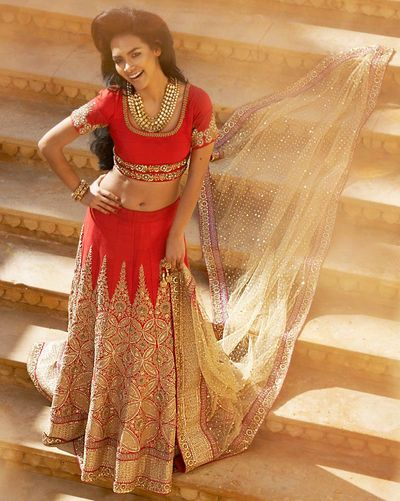 Photo of red and gold lehenga