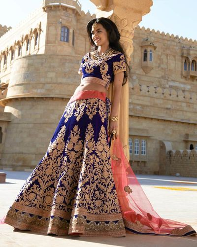 Photo of deep blue and gold lehenga