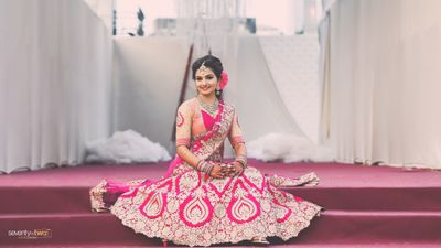 Photo of Coral blouse and bright pink lehenga