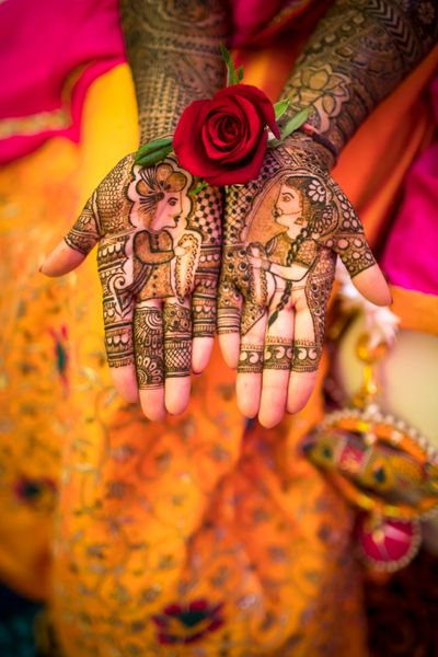 Photo of Modern mehendi with bride and groom caricatures