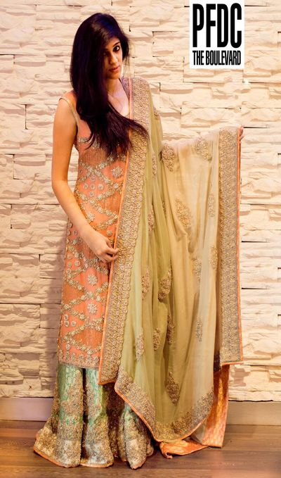 Photo of peach heavy embellished sharara with mint green silk sharraa pant and gold dupatta