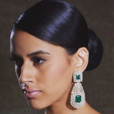 Photo of large diamond and emerald drop earrings