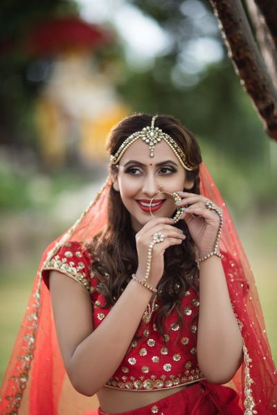 Photo of Modern bridal with open hair and jewellery in red lehenga