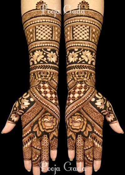 Photo of Stunning bridal mehendi with lotus motif designs