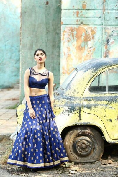 Photo of Deep blue lehenga with butis and collared blouse
