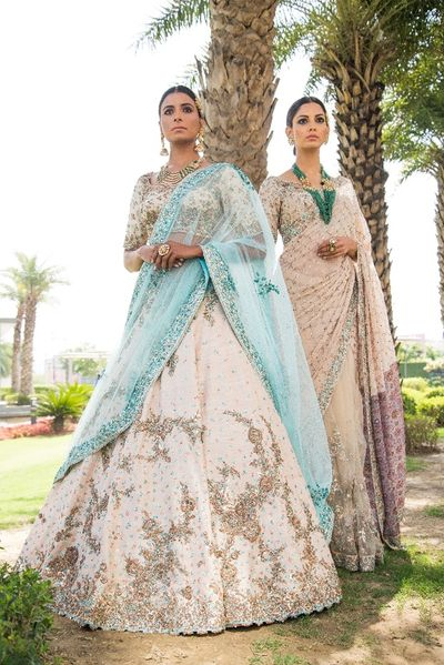 Photo of Cream and blue engagement lehenga