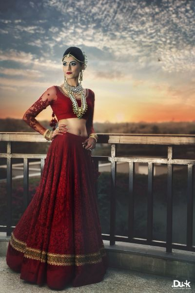 Photo of red bridal lehenga with threadwork and pearls in red