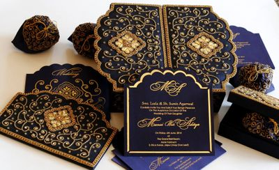 Photo of navy blue and gold wedding cards