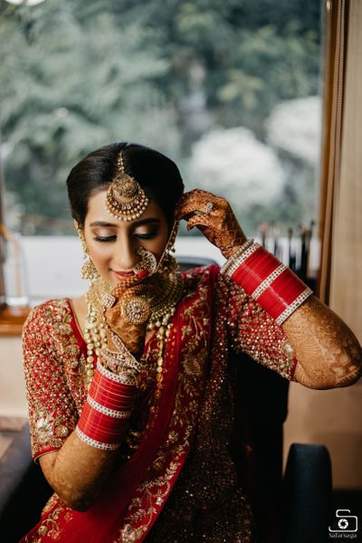 Photo of Bride getting ready shot wearing Nath
