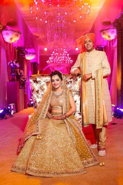 Photo of Bride in all gold sequin bridal lehenga