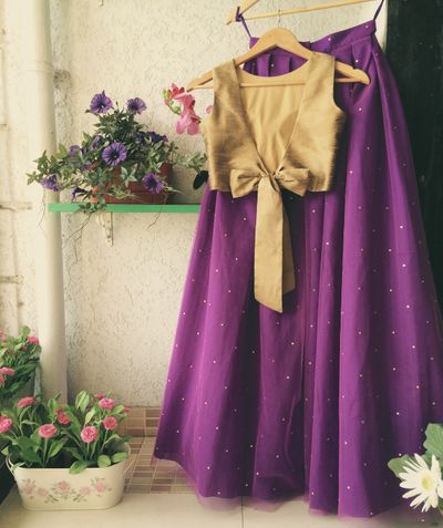 Photo of Light purple lehenga with gold blouse with a bow