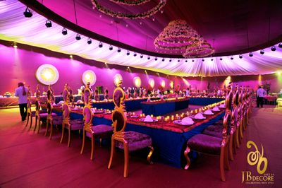 Photo of Purple and gold royal table setting