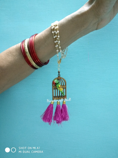 Photo of Parrot bangles with birdcage as mehendi favours