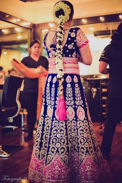 Photo of Indigo Blue and Hot Pink Lehenga with Gajra Hairstyle