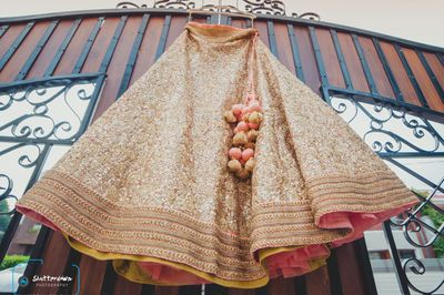 Photo of Sequins Gold Lehenga on a Hanger