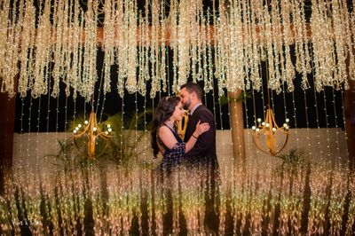 Photo of Couple shot with floral sangeet decor