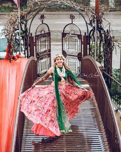 Photo of Mehendi bridal shot with floral lehenga and wreath