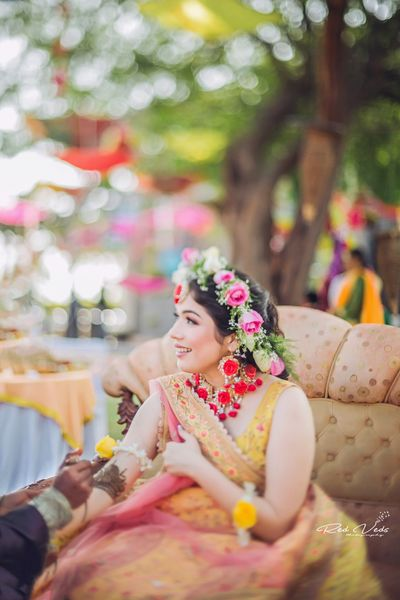 Photo of Mehendi floral jewellery with floral crown