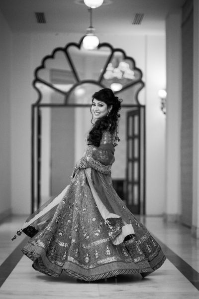 Photo of Twirling Bride in a Lehenga Photography