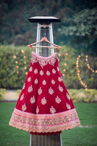 Photo of Maroon Velvet Bridal Lehenga on a Hanger