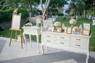 Photo of Photo display idea with white and gold theme on entrance