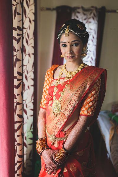 Photo of Orange kanjivaram with buti print blouse