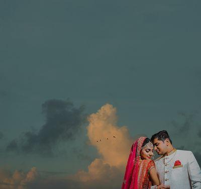 Photo of Wedding day couple shot outdoors